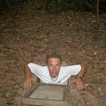 Eric emerging from one of the Cu Chi tunnels in Vietnam