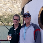 Best selling author Ridley Pearson and Eric aboard the old steamer Earnslaw in New Zealand