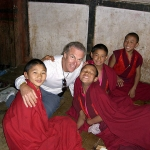 Eric with young monks in Bhutan monastery